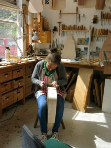 Claire in her tidy workshop